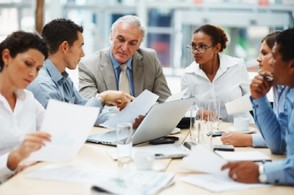 Picture of older Americans working in an office  at a round-table session.