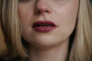 Picture: Lips of a Woman with Blond Hair
