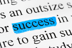Picture: Text from a page with the word SUCCESS highlighted in blue.